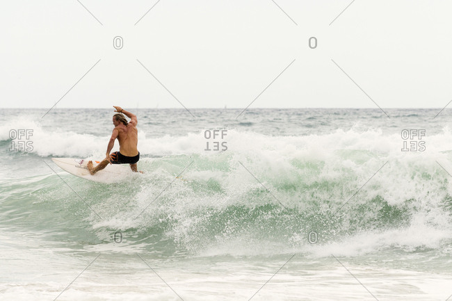 Surfer enjoying a wave - Moffat Beach, Queensland