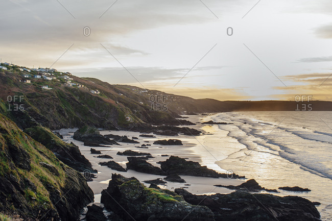 Sunset across the coastal headland and bay of the Rame Head Heritage Coast on the English Channel