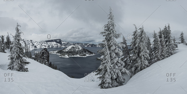 Scenic view of Wizard Island at Crater Lake National Park during winter