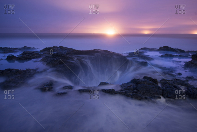 High angle scenic view of Thor's Well against sky during sunset