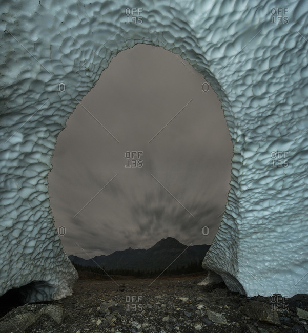 Scenic view of Big Four Mountain seen through ice cave's entrance at Cascade National Park