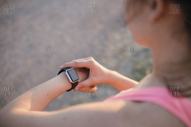 Athletic woman checking her statistics on a smart watch