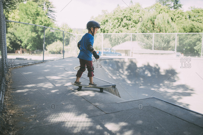 Full length of boy skateboarding at skateboard park