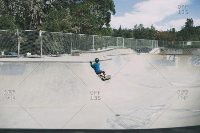Boy fell while skateboarding at skateboard park
