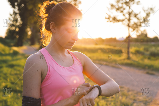 Athletic woman checking her smart watch