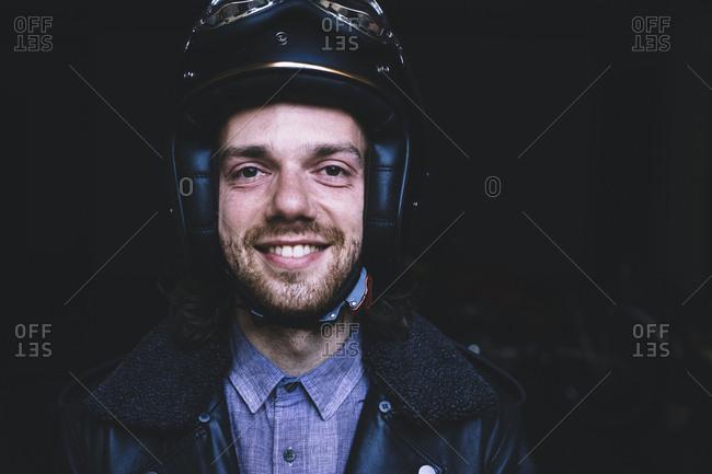 Portrait of happy biker in workshop
