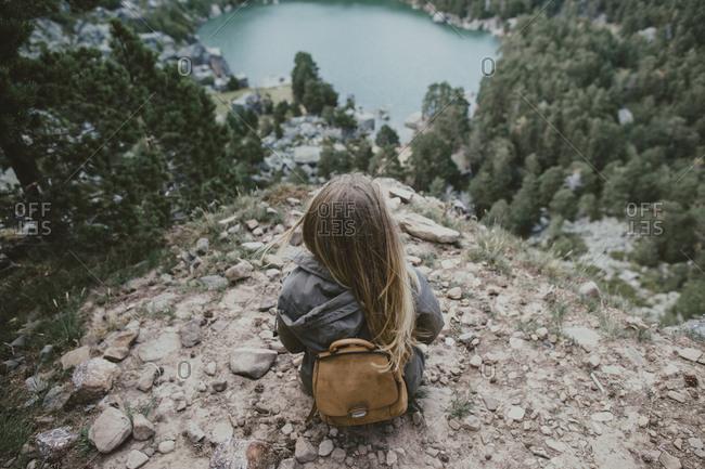 Woman overlooking a mountain lake