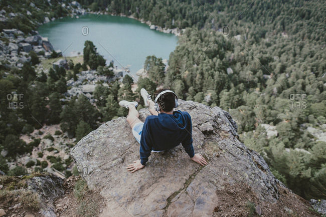 Man with headphones in mountain setting
