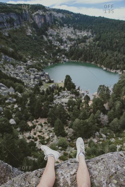 Feet over a scenic mountain setting