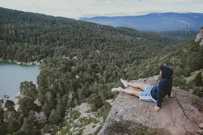 Young man gazing at mountain range