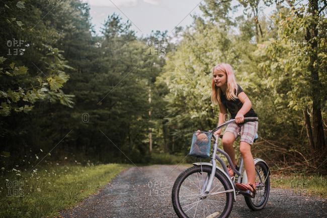 Girl on bike on a rural path