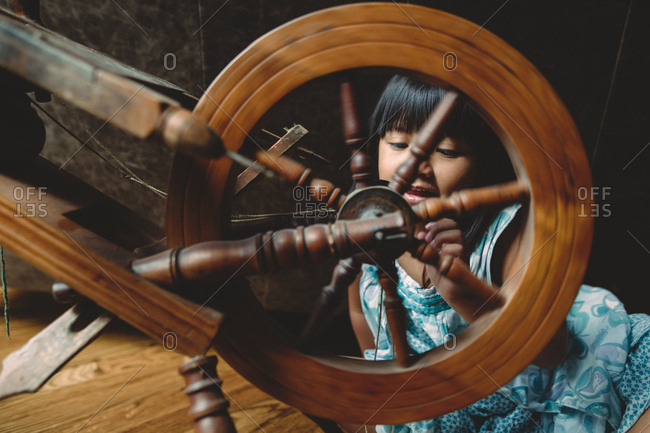 Girl looking at a spindle
