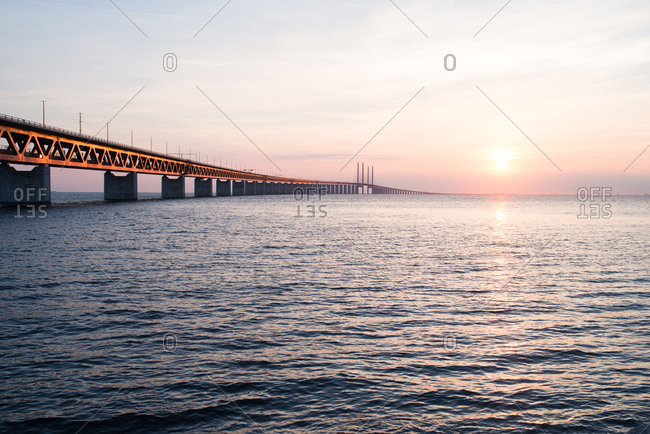 Sun setting over long bridge