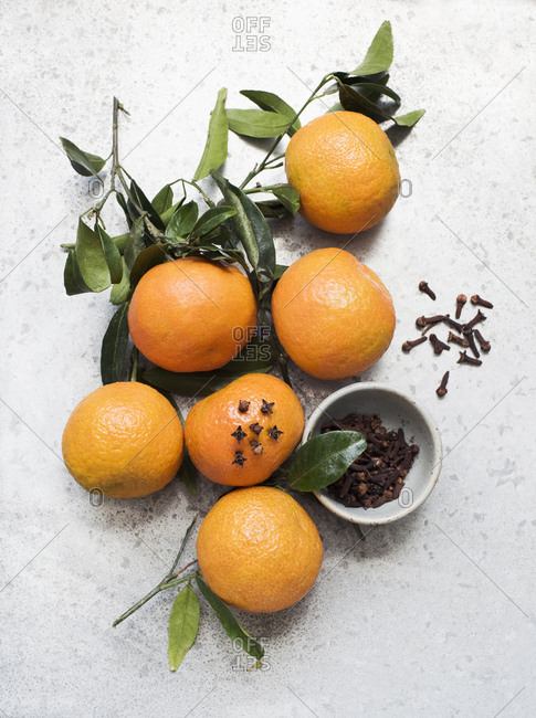 Overhead view of oranges decorated with cloves