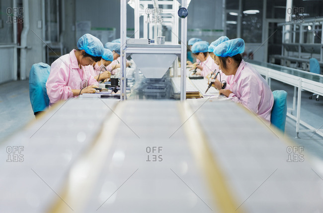 Female workers in solar panel assembly factory, Solar Valley, Dezhou, China