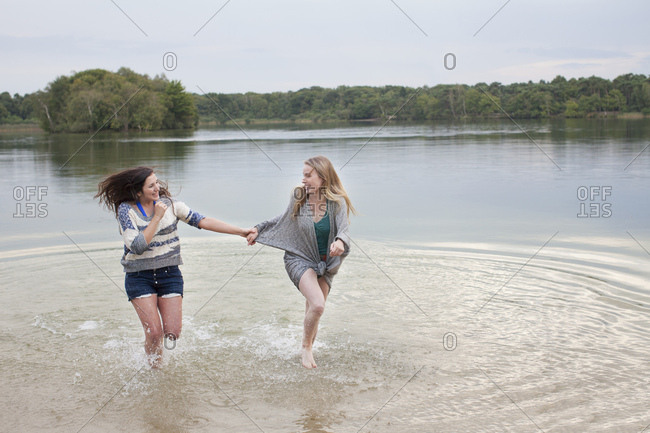 Young women playing in lake