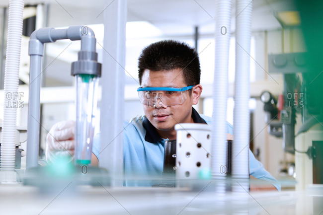 Man wearing safety goggles in flexible electronics plant