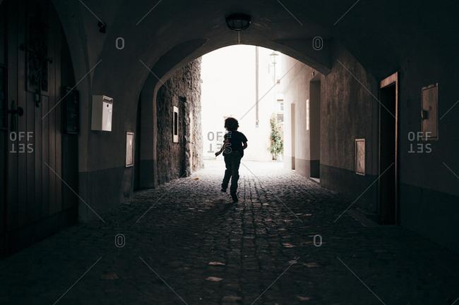 Rear view of boy running through tunnel, Bludenz, Vorarlberg, Austria