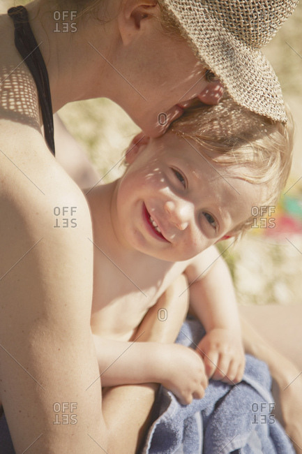 Close up of mature woman with son on her lap, Lopar, Rab Island, Croatia
