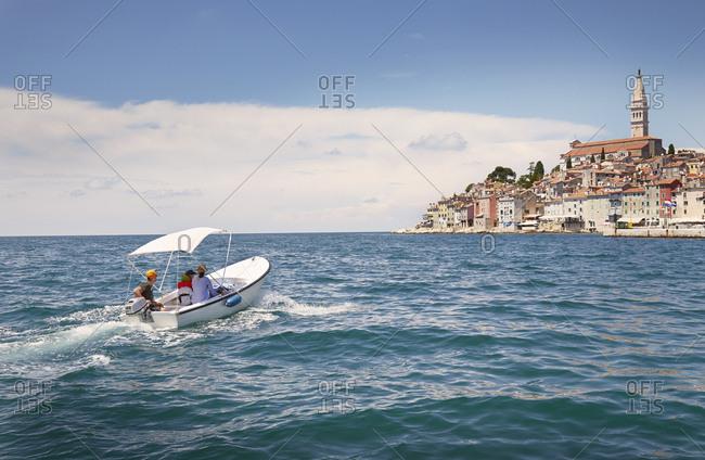 Family with two children in motor boat, Rovinj, Istria Peninsula, Croatia