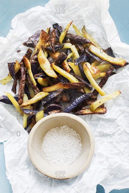 Colourful french fries with sea salt, close-up