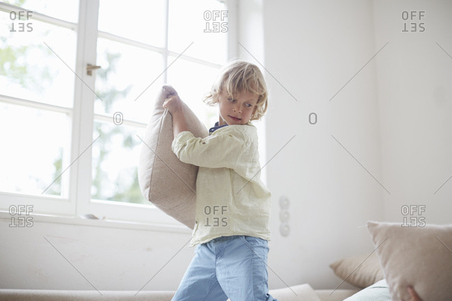 Boy holding pillow preparing to throw