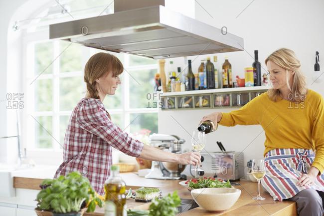 Women preparing meal in kitchen