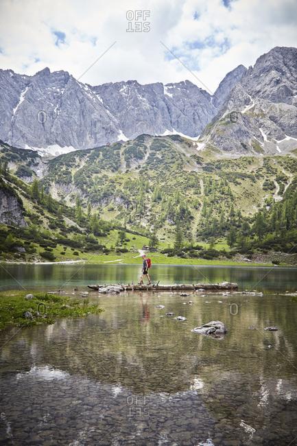 Young boy exploring lake, Ehrwald, Tyrol, Austria