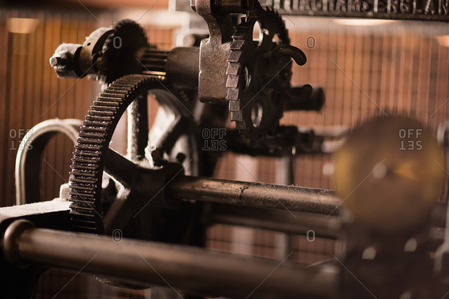 Iron cogs on old weaving machine in textile mill
