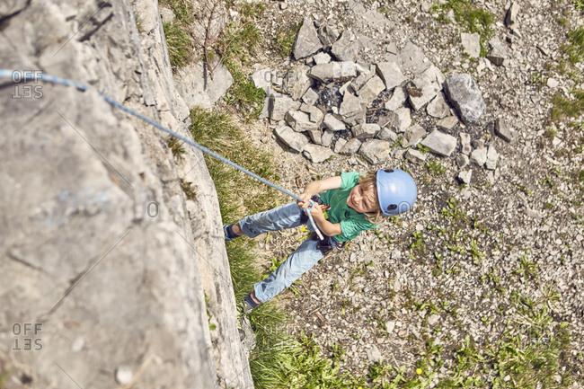 Boy rock climbing, Ehrwald, Tyrol, Austria