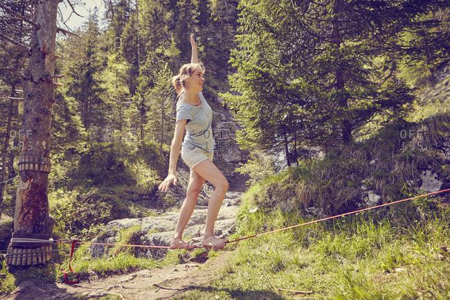 Woman balancing on rope, Ehrwald, Tyrol, Austria