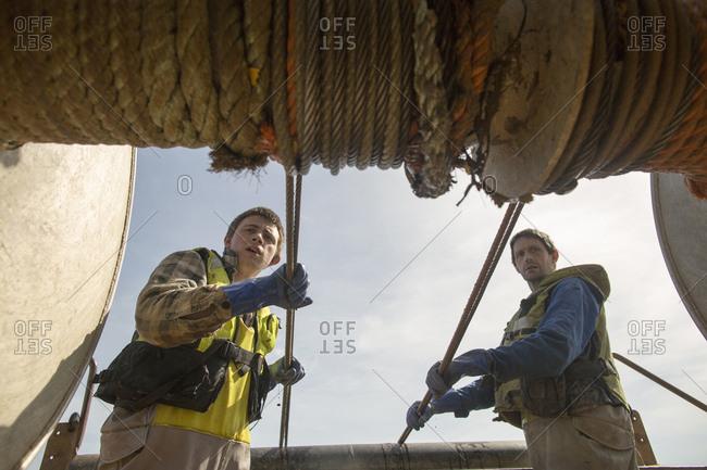 Fishermen reeling in net
