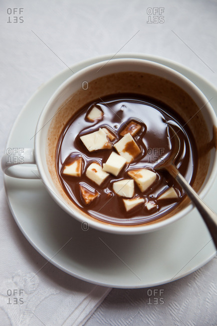 Cup of hot chocolate with cubes of cheese