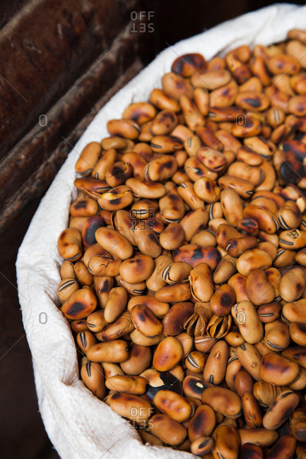Whole roasted beans in a cloth-lined basket