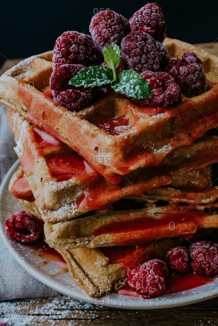 Waffles with fresh raspberries and raspberry jam
