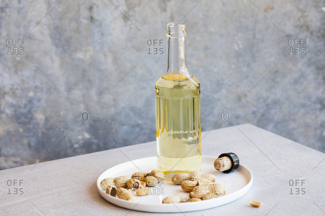 Peanuts with a bottle of peanut oil