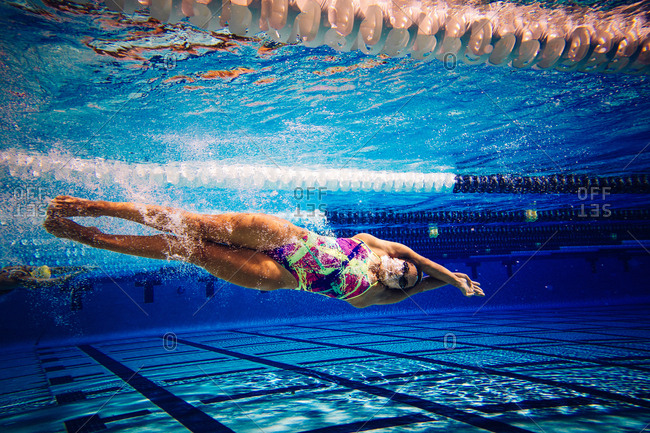 Swimmer underwater in pool