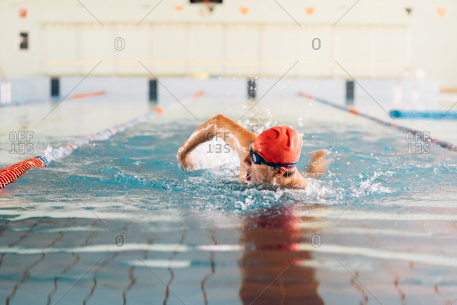 Senior man swimming in swimming pool