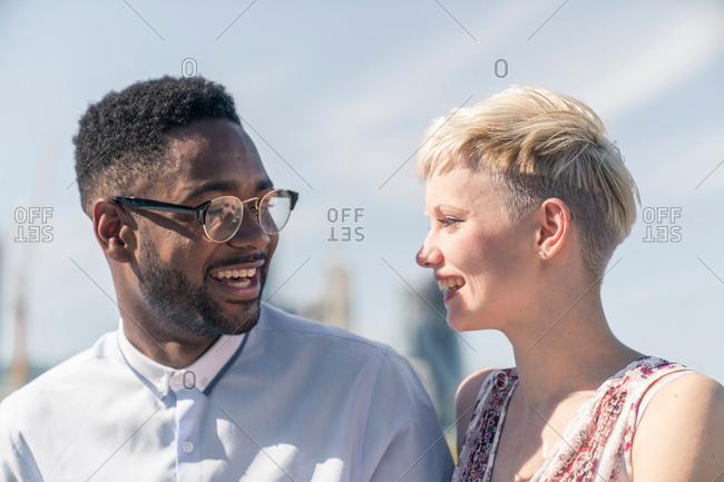 Young couple laughing together outdoors