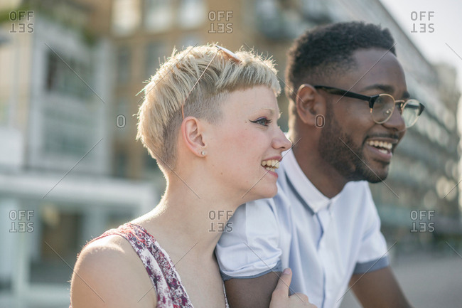 Young couple outdoors, smiling