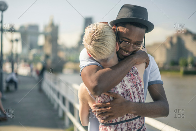 Young couple outdoors, hugging