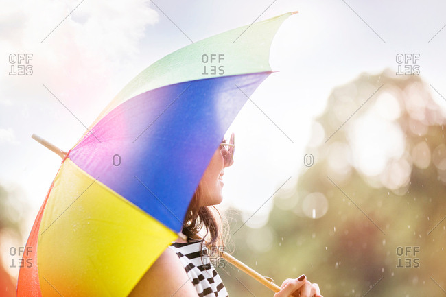 Portrait of woman with umbrella looking away