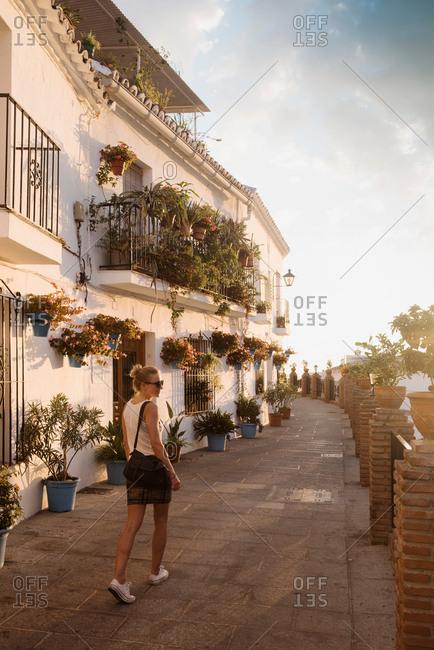 Woman walking in Mijas Pueblo, Andalucia, Spain