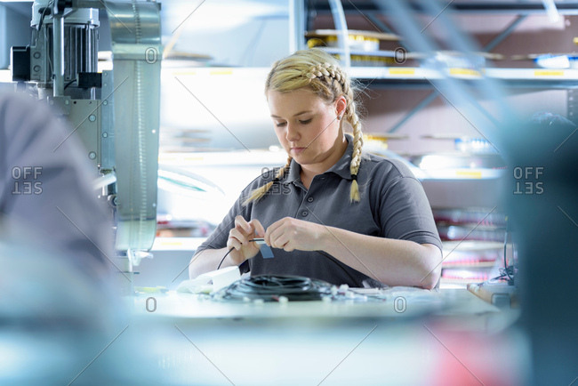 Female apprentice electrical engineers in cable finishing factory