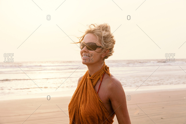 Portrait of woman on beach looking away smiling, Goa, India, Asia