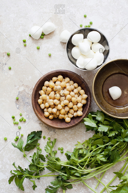 Food still life with bowls of chickpea, mozzarella and parsley