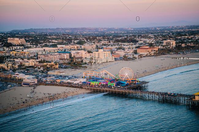 March 17, 2016: Pier and beach with amusement park, high angle, Santa Monica, California, USA