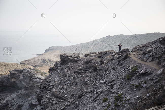 Rocky landscape with a man observing it near the sea in Murcia, Spain