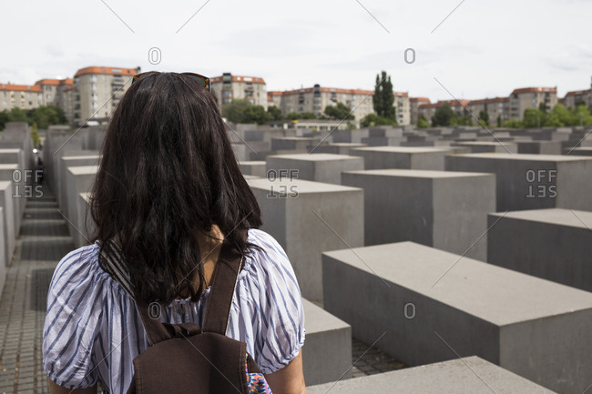 Woman at a Holocaust memorial in Berlin, Germany