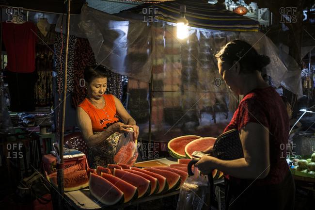 Yangon, Myanmar - 19 September 2016: Watermelon seller at downtown Yangon